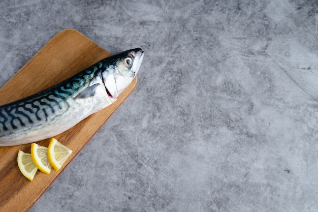 Mackerel on wooden background on marble background. copy space.