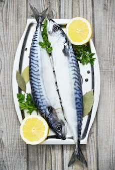 Mackerels fresh served on silver plate with lemon