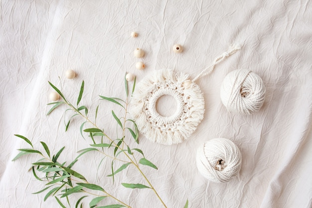 Macrame cotton decor. natural materials - cotton thread, wood beads. eco decorations, ornaments, hand made decor. copy space