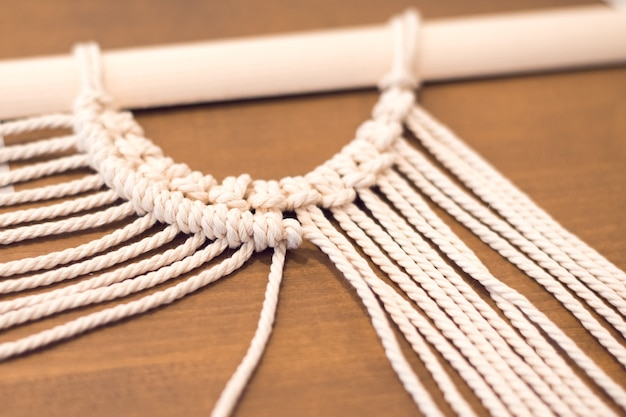 Macrame workshop workind process of creating panel for home decor