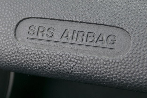 Macro of an airbag sign on a dashboard