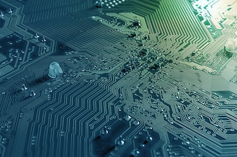 Macro background of circuit board and microchip on mainboard pc desktop
