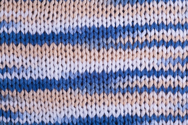 Macro background texture of striped knitted texture