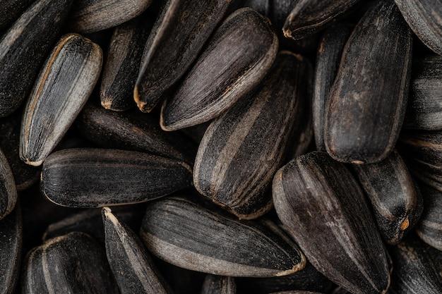 Macro of black sunflower seeds background