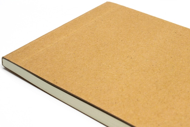 Macro of blank notebook corner with cardboard hardcover isolated on white