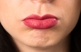 Macro - Close up lips of sad young woman