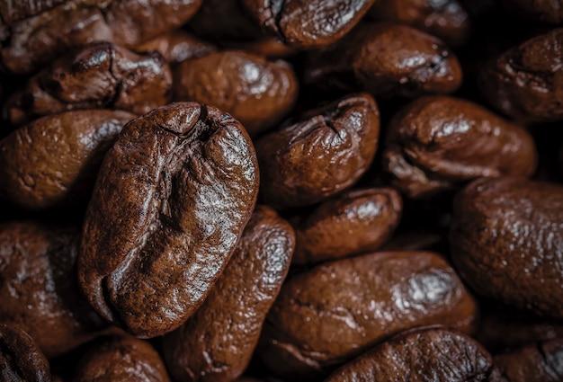 Макро кофе в зернах текстуры фона