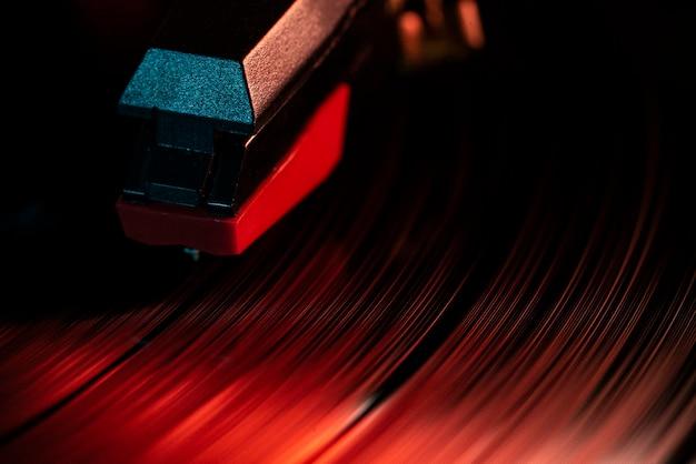 Macro detail of needle on vinyl record disc
