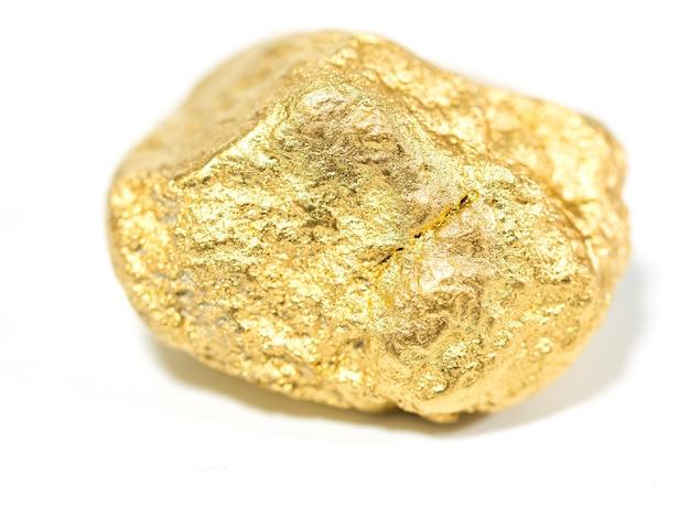 Макро золотая руда в валуне