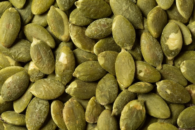 Macro green pumpkin seeds  texture .
