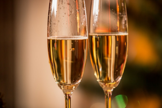 Macro image of champagne bubbles in two glasses