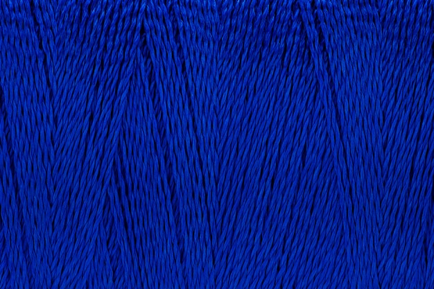 Macro image of thread texture blue color background