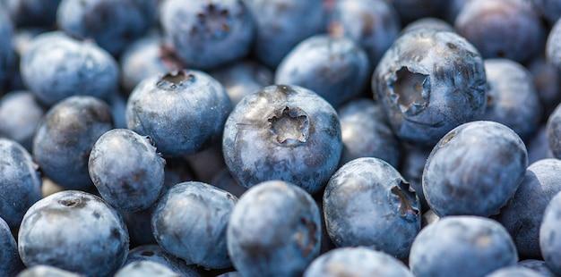 新鮮なバイオブルーベリーベリーのマクロ、フルーツの食品コンセプト