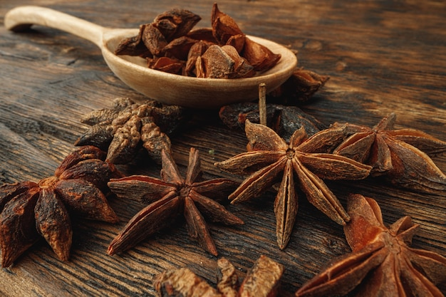 Macro photo of anise stars spice on wooden background