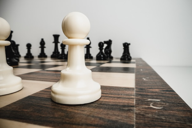 Macro photo of chess pieces on a wooden chess board