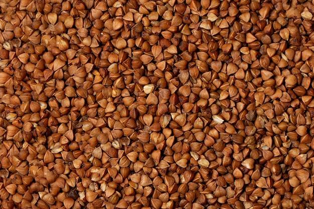 Macro photo food buckwheat groats. texture background grain buckwheat groats. image food product porridge buckwheat.