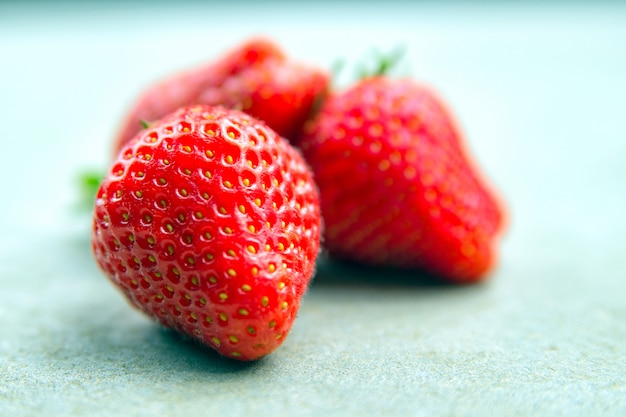 Macro photo of a ripe red large strawberry with a small depth of field