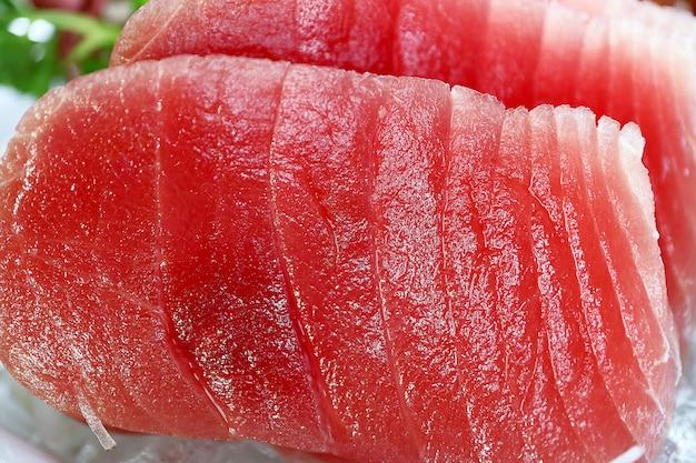 Macro photo sliced tuna fish sashimi at the japanese restaurant.