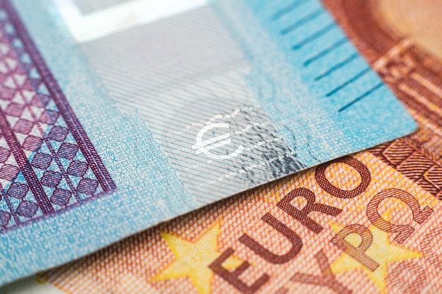 Macro photograph of the word euro on a euro banknote
