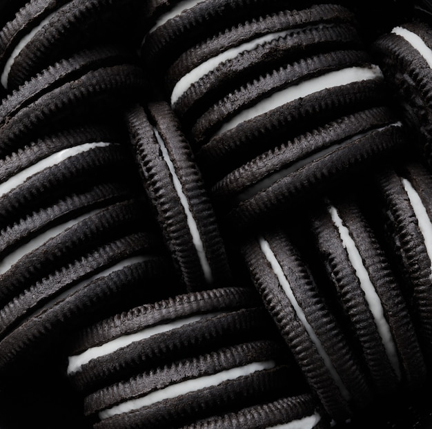 Macro photography of a bunch of oreo cookies.