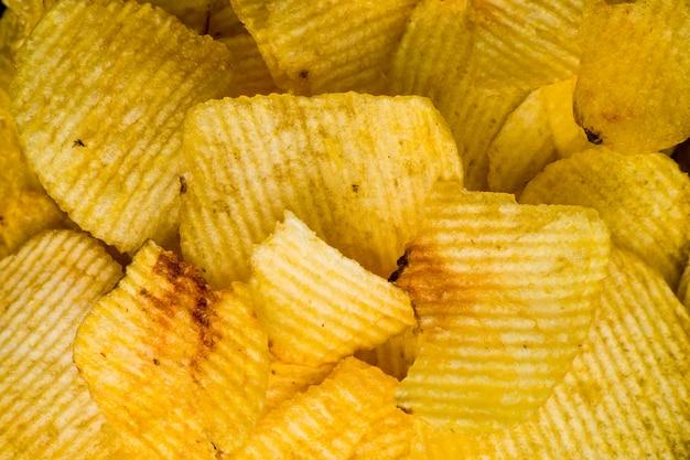 Macro photography of a plate of crisps potatos. unhealthy concept