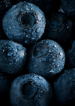 Macro picture of group of blueberries and dew drops background