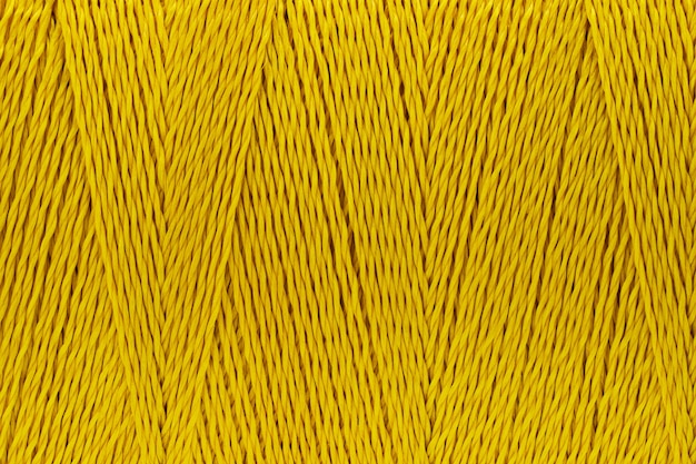 Macro picture of thread texture gold color background