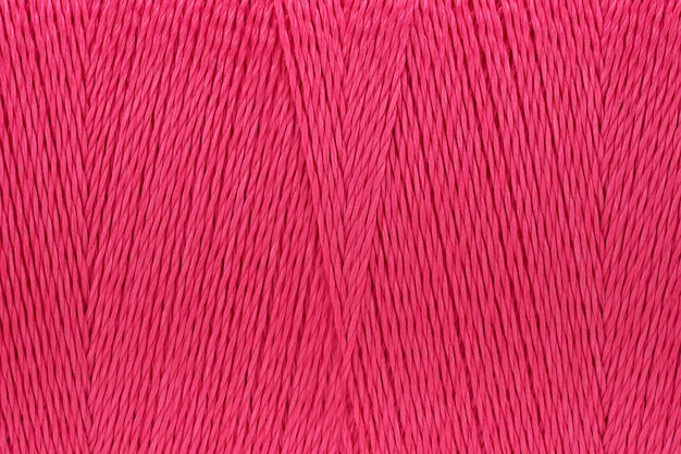 Macro picture of thread texture pink color background