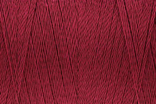 Macro picture of thread texture red crimson color background