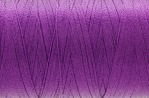 Macro picture of thread texture violet color background