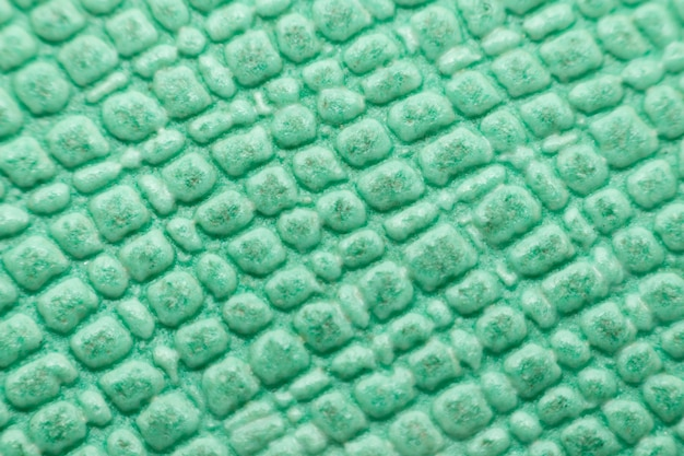 Macro of rubber gym floor texture surface green color use for background