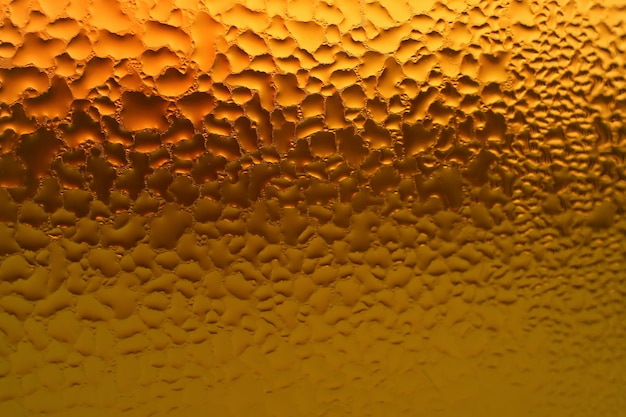 Macro shot of condensation on the bottle full of mixed herbs juice