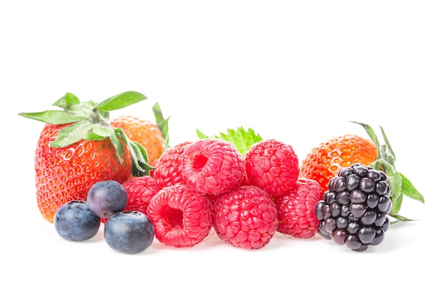 Macro shot of fresh raspberries, blueberries, blackberries and strawberry with leaves isolated