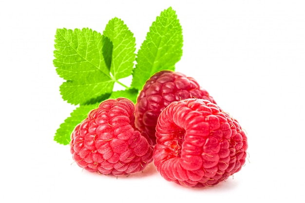 Macro shot of fresh raspberries with leaves isolated o
