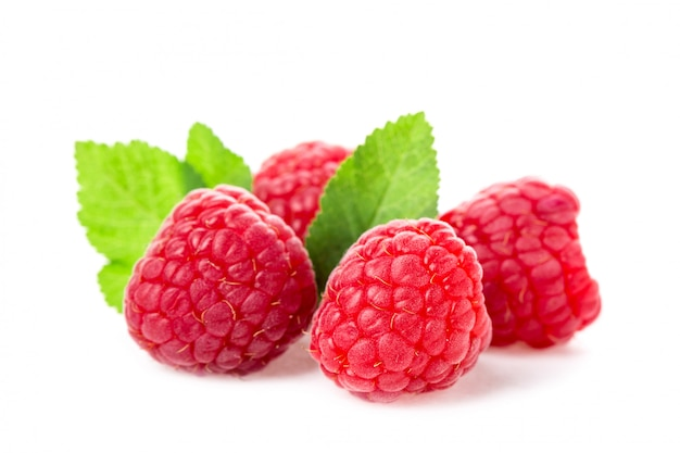 Macro shot of fresh raspberries with leaves isolated