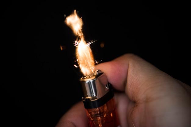 Macro shot of hand holding lighter