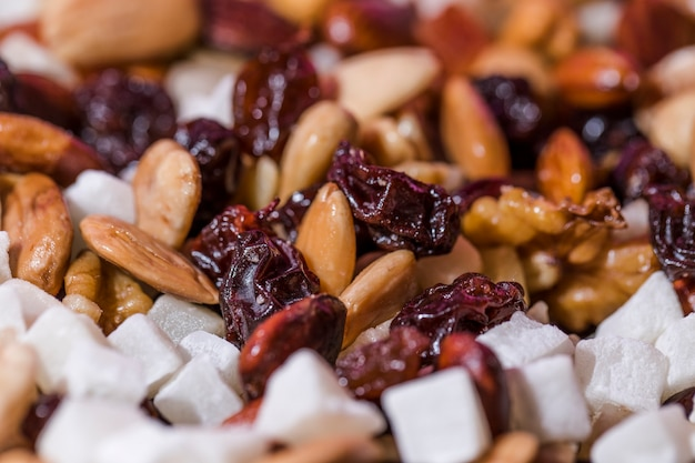 Macro shot of mixed nuts and fruits