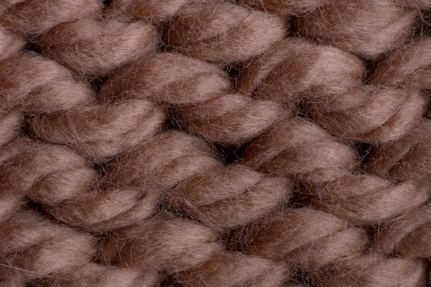 Макросъемка текстуры коричневой шерстяной трикотажной ткани.
