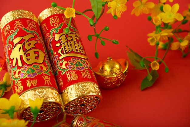 Macro shot of tet decorations against red background