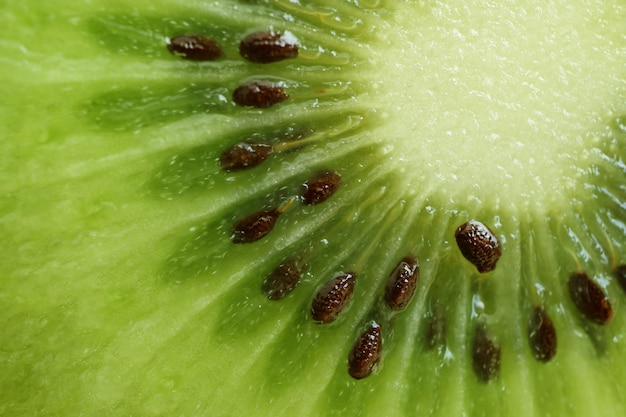 Macro shot of vibrant green fresh and juicy of cut ripe kiwi fruit for texture and background
