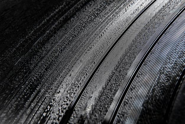 Macro shot of a vinyl record track textures