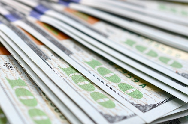 Macro shot with shallow depth of field. hundred us dollar bills
