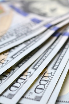 Macro shot with shallow depth of field. hundred us dollar bills