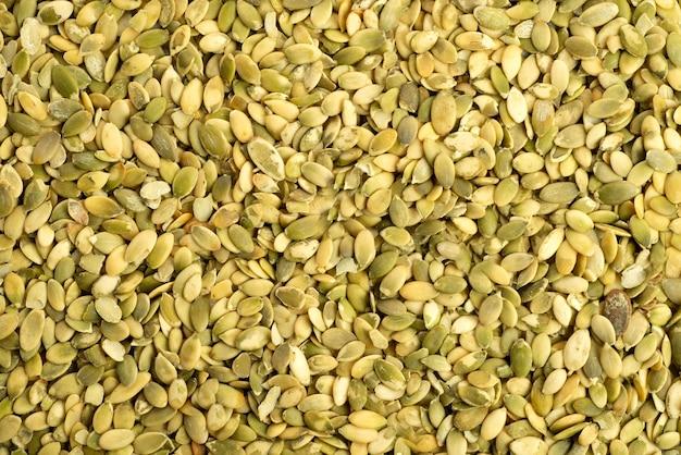 녹색 호박 씨앗의 매크로 표면 질감