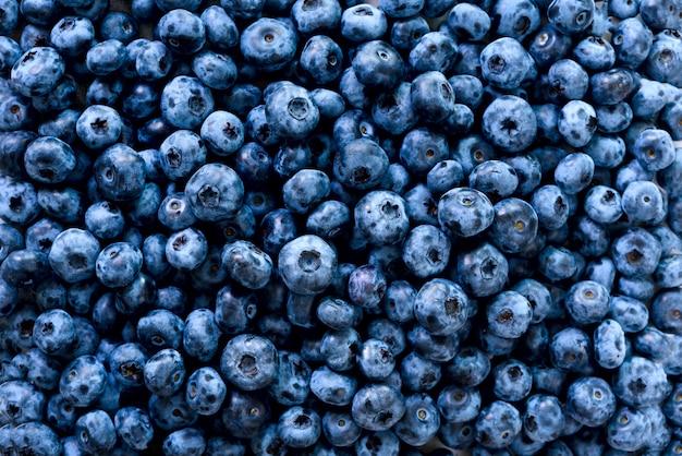 ブルーベリーの果実のマクロテクスチャをクローズアップ。夏、ビタミン、ビーガン、ベジタリアンのコンセプトです。健康食品。新鮮なブルーベリーの背景