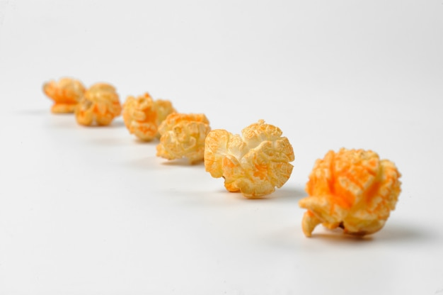 Macrophotograpy of a set of popcorn arranged in a line