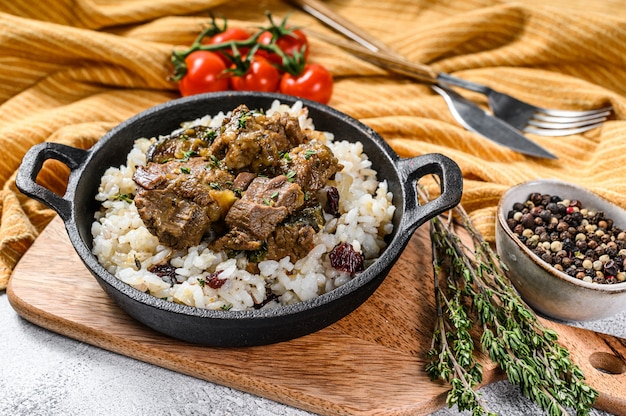 Madras beef with basmati rice, indian food.  white background. .