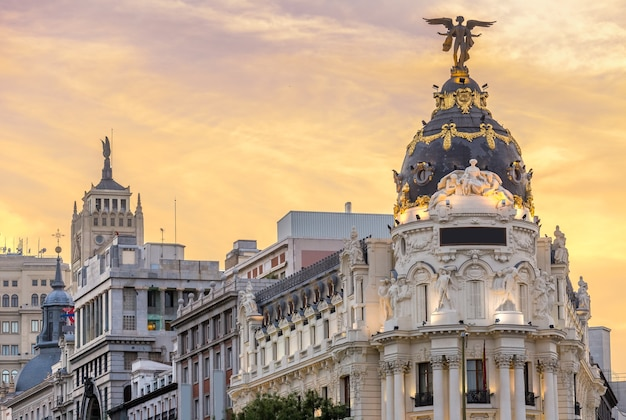 Madrid downtown in gran via main shopping street with traffic light during twilight sunset