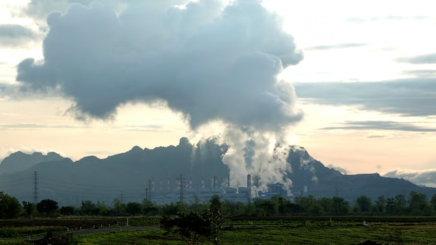 Mae moh coal power plant with smoke and toxic air from chimney.