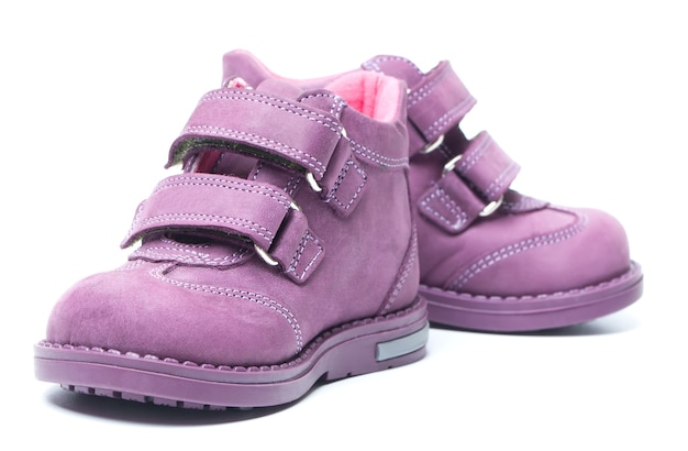 Magenta children`s boots isolated